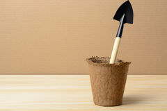 Peat pot and shovel Stock Photography