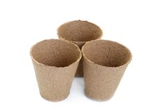 Peat pots. Three empty peat pots shot over white background Royalty Free Stock Photos