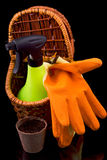 Peat pots for seedlings, rakes, sprayer ,orange gloves and a bas Stock Images