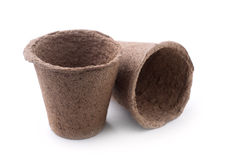Peat Pots. Two Biodegradable Peat Moss Pots   On White Background Stock Images