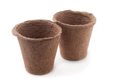 Peat Pots. Two Peat Pots  Isolated On White Background Royalty Free Stock Photos