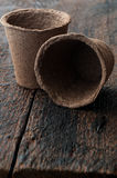 Peat Pots. Two Peat Pots on is  wooden background Royalty Free Stock Photos