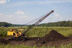 Peat quarry. Old dragline (excavator) on the peat quarry in the swamp royalty free stock images