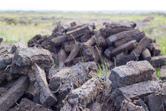 Peat stacked up for the bog winds to dry Royalty Free Stock Photography