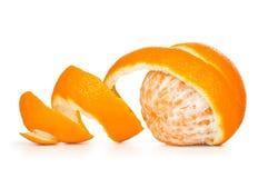 Peau épluchée par orange Photo stock