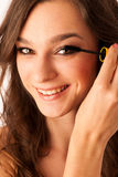 Peautiful hispanic woman applying mascara on her eyelashes Royalty Free Stock Photo