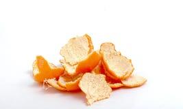 Peaux de mandarine sur le fond blanc photo libre de droits