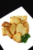 Peaux de pomme de terre cuites au four par four 1 Image stock