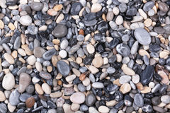 Pebble. Structure from a motley sea pebble stock image