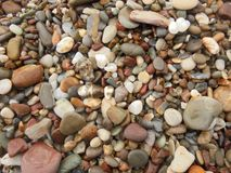 Pebble. Abstract background with sea or river smooth stones stock photo