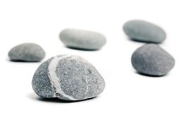 Pebble arrangement. Pebbles arranged onto white background Stock Photo