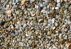 Pebble background. Overhead view of brown and gray pebbles or stones Royalty Free Stock Photo