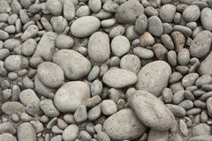 Pebble background Stock Images