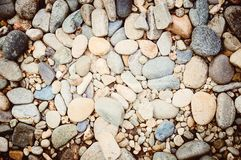 Pebble background.The texture of the stones. Beautiful backdrop. royalty free stock images