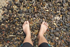 Pebble barefoot Royalty Free Stock Images