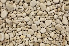 Pebble Beach Background. Smooth pebbles on a beach in Door County Wisconsin Stock Photo