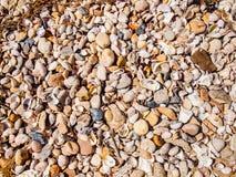Pebble Beach bakgrund Fotografering för Bildbyråer