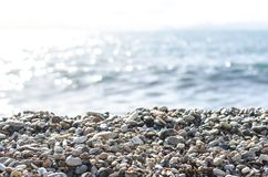 Pebble beach and blue sky on background. Mediterranean Sea. Athens, Greece.  stock images