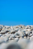 Pebble beach and blue sky on background. Pebble Beach on a sunny day. shallow depth of field Stock Images