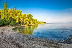 Pebble beach on Brac island with turquoise clear ocean water, Supetar, Brac, Croatia.  stock photography