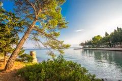 Pebble beach on Brac island with turquoise clear ocean water, Supetar, Brac, Croatia.  stock image