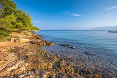 Pebble beach on Brac island with turquoise clear ocean water, Supetar, Brac, Croatia.  stock images