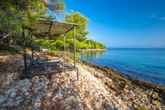 Pebble beach on Brac island with turquoise clear ocean water, Supetar, Brac, Croatia.  royalty free stock images