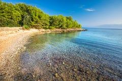 Pebble beach on Brac island with turquoise clear ocean water, Supetar, Brac, Croatia.  royalty free stock photo
