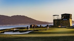Pebble Beach Golf. Pebble Beach, California, February 17, 2018: The famous 18th hole at the Pebble Beach golf links offers assorted seaview vistas in addition to royalty free stock photo