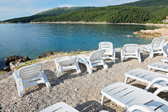 Pebble beach with chaise-longues in Istria Royalty Free Stock Photo