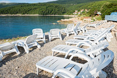 Pebble beach with chaise-longues in Istria Stock Image