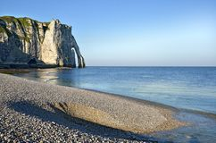 Pebble beach and cliff of Etretat in France Royalty Free Stock Images