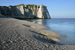 Pebble beach and cliff of Etretat in France Stock Photography
