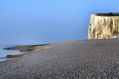 Pebble beach and cliff. In the Somme bay in France Royalty Free Stock Photos
