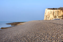 Pebble beach and cliff. In the Somme bay in France Stock Photos