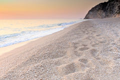 Pebble beach at dawn in Lefkada, Greece Stock Images