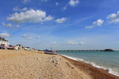 Pebble beach English Channel Deal Kent England. Deal beach,looking north to the pleasure pier and nice blue sky with white patchy clouds , Deal Kent Great Stock Photos
