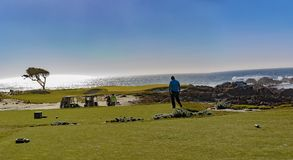 Pebble Beach Golf. Point Joe,  Del Monte Forest, California, February 17, 2018: Golf course views of seaside links of the Monterey Peninsula Country Club Royalty Free Stock Photo