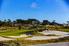 Pebble Beach Golf. Point Joe,  Del Monte Forest, California, February 17, 2018: Golf course views of seaside links of the Monterey Peninsula Country Club Stock Image