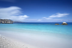 Pebble beach on a Greek island Stock Photos