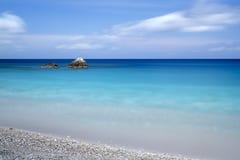 Pebble beach on a Greek island Royalty Free Stock Photo