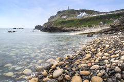 Pebble beach and headland Royalty Free Stock Photography