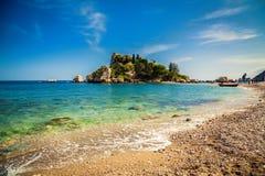 Pebble beach Isola Bella in Taormina. Pebble beach in front of the island Isola Bella in Taormina, Sicily royalty free stock image