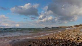 Pebble beach of Lake Baikal in autumn. Landscape. Sea shore, splashing waves stock video footage