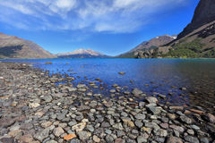 Pebble beach at the lake Stock Photography