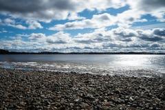 Pebble beach on lakeshore Stock Images
