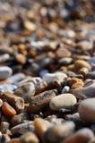 Pebble beach. Narrow depth of field shot of pebbles on a beach in East Anglia stock photos