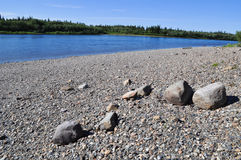 Pebble beach North of the river. Stock Photos