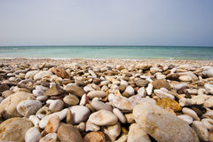 Pebble beach, Oman Royalty Free Stock Images