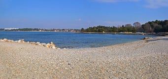 Pebble beach panorama Stock Photos